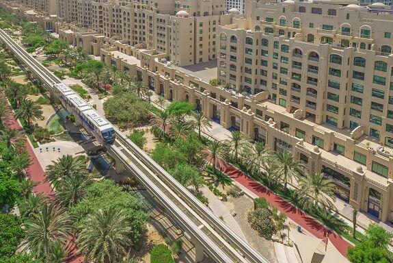 An aerial photo Al-Ittihad Park in Dubai near Palm Monorail's railway
