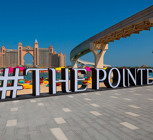 The Pointe's hashtag marquee with Atlantis Hotel appearing in the background of the photo